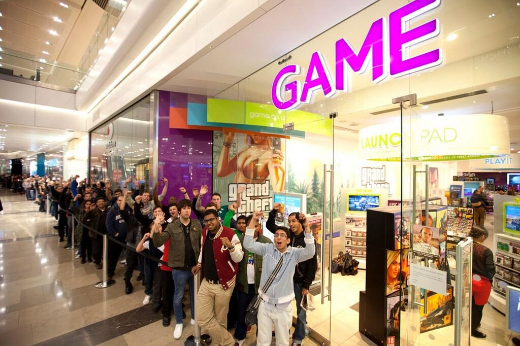 Zohair-Ali-is-first-in-the-queue-to-pick-up-a-copy-of-Grand-Theft-Auto-V-at-the-GAME-store-in-Westfield-London
