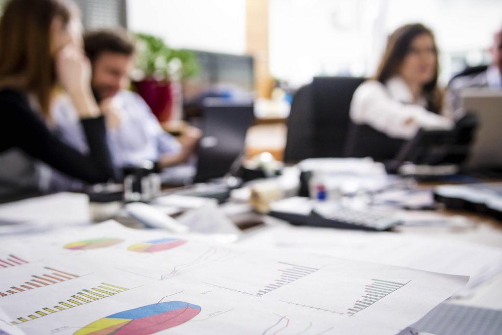 Graphs business data on office desk