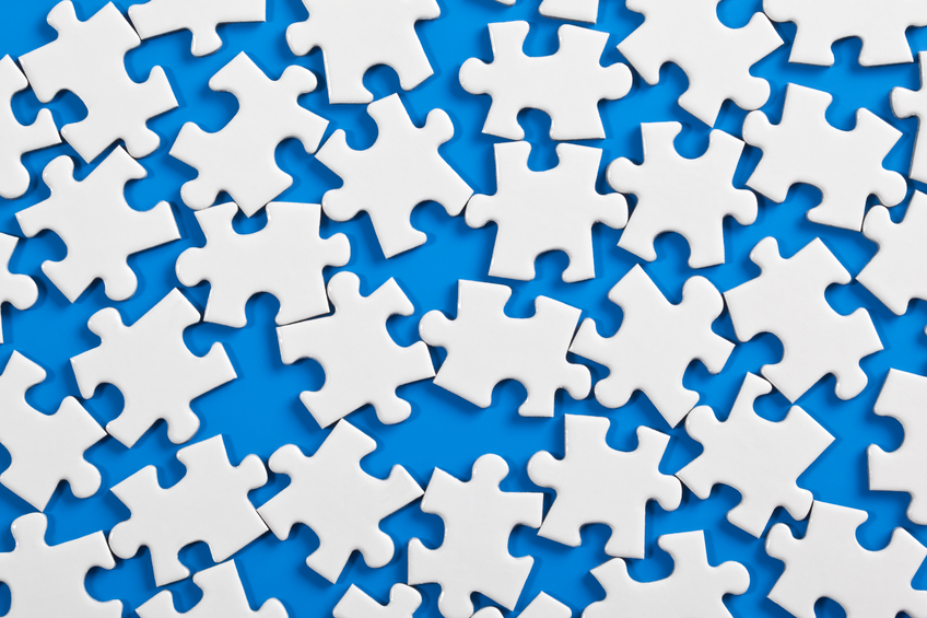 Scattered jigsaw representing STP process
