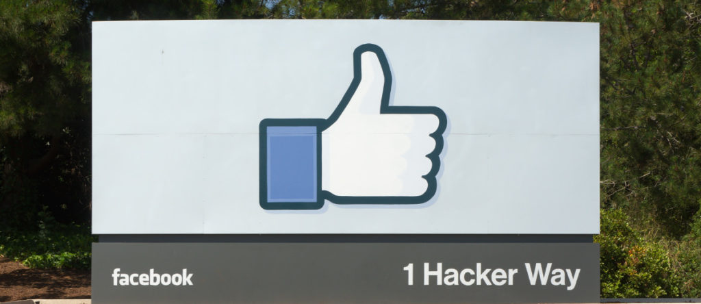 The entrance sign to Facebook 1 Hacker Way